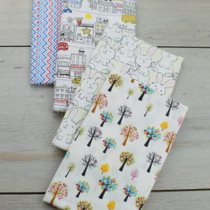Set de 4 telas precortadas especiales para patchwork en color blanco con dibujos estampados